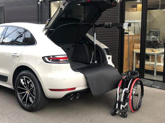 Hosting a wheelchair up into a car with a Carolift 40