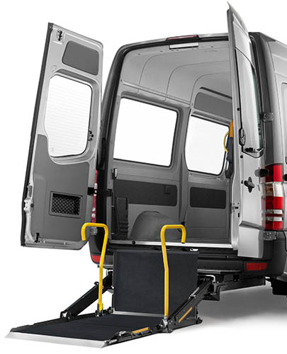 Unfolded and lowered Cassette lift installed on the rear of a van