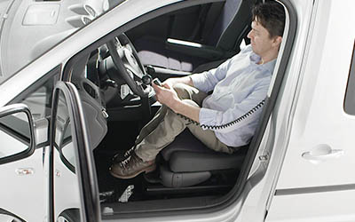 Man adjusting his seat on a Turny Evo by using the hand control