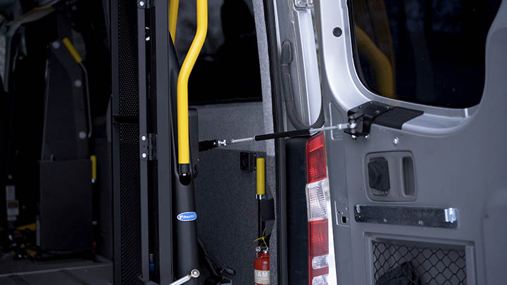 Q-Series wheelchair lift in the back of a van