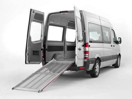 Van with the back doors open showing an unfolded tailboard ramp