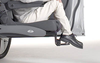 Man sitting on swivel seat with feet on foot rest