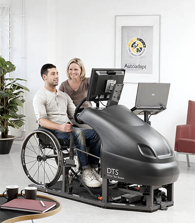 Man sitting in a DTS with a woman beside him