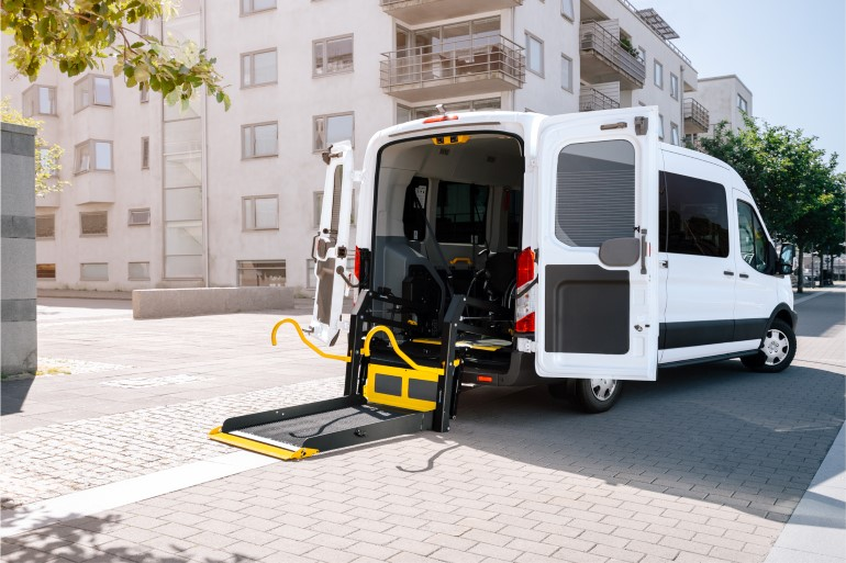 E-Series wheelchair lift folded out from a van
