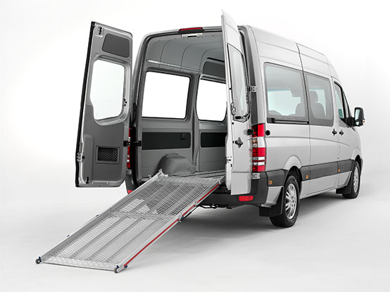 Van with the backdoors open showing a unfolded ramp