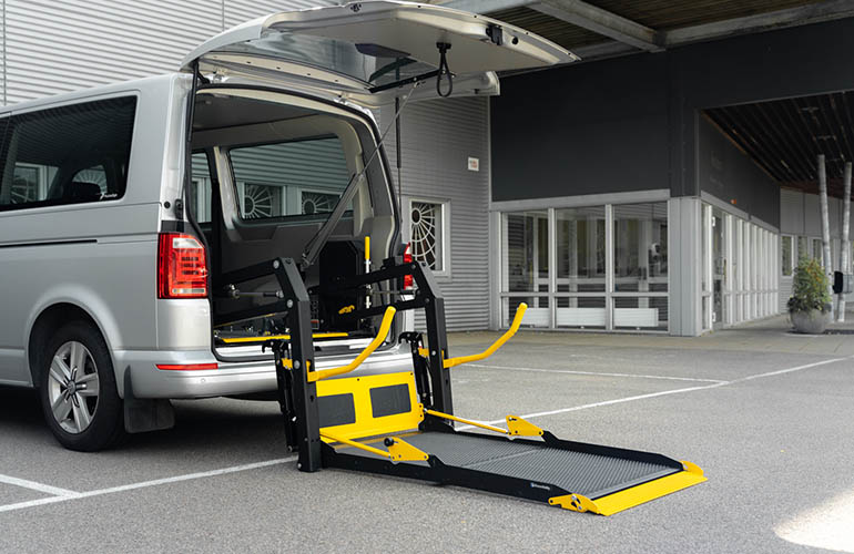 E-Series folding platform wheelchair lift in a Volkswagen Transporter.