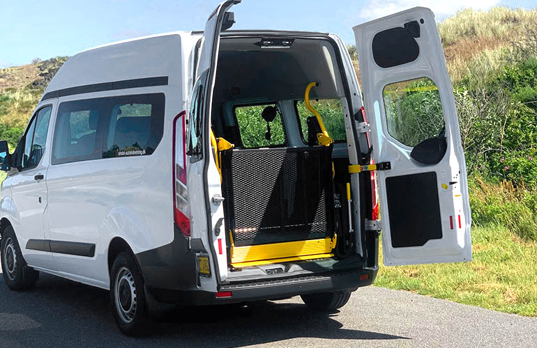 E-Series folding platform wheelchair lift in a Ford Transit.