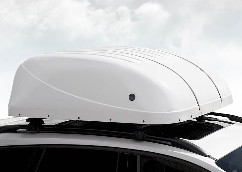 Image of a chair topper installed on top a car